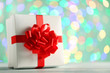 Gift box with ribbon on lights background