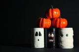 Halloween monsters with pumpkins on dark background - 222036988