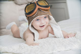 the baby is dressed as a pilot - 222037520
