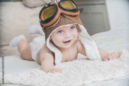 the baby is dressed as a pilot © denissimonov