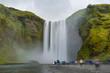 Skogafoss waterfall Iceland among green hills in the summer