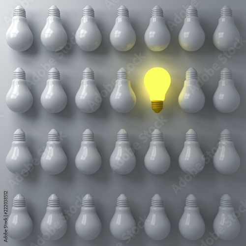 One glowing light bulb standing out from the unlit or dim bulbs on dark white background individuality and think different the business creative idea concepts 3D rendering - 222038512