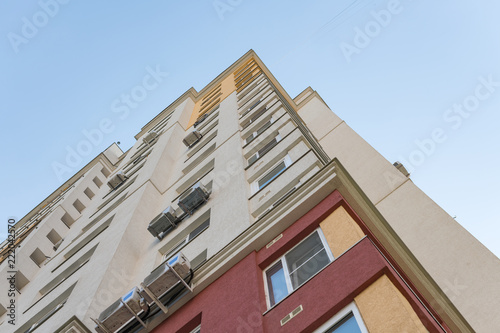 Foto Murales New high rise block building with air conditioners on facade. Modern apartments style.
