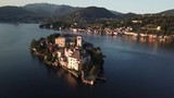 Drone surrounding San Giulio island in Italy - 222043142