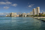 Hotels and tourists vacation on Waikiki Beach shore by the Pacific Ocean in Honolulu Oahu Hawaii USA - 222053957