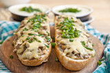 casserole with cheese and mushrooms sprinkled with fresh chive - 222055522