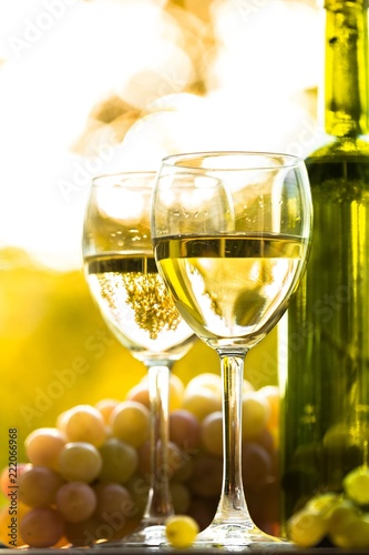 Wine Glasses With Wine Bottle And White Grape Cluster