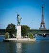 Paris, France - 08 18 2018:  Les Quais de Seine - Bateau mouche et Statue de la liberté