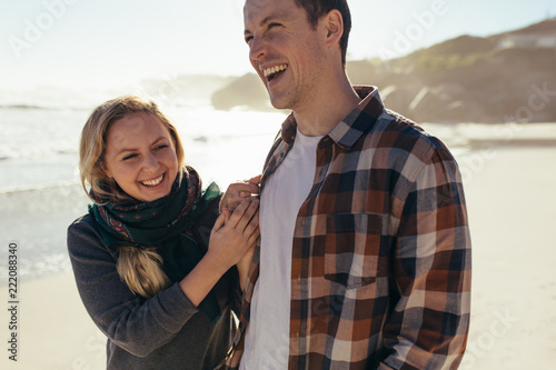 Cheerful couple together along the sea shore