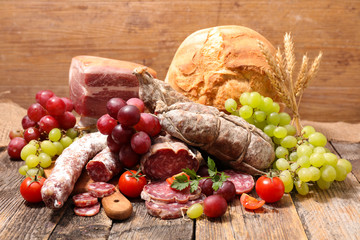 selection of sausage, salami and bread