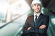 Young handsome engineer in white hardhat
