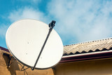 Satellite dish on the wall of a country house - 222098359