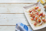 Ceviche with salmon, tomato, onion, lemon - 222099579