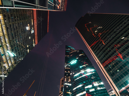 Modern Futuristic Skyscrapers Buildings In Business Center Moscow City At Night With Illuminated Windows And