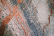 Natural Red Blue Marble Stone Surface Texture. Mixed Colors Abstract Background.