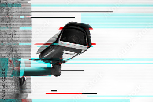 Close up of security camera with digital glitch effect | Buy Photos
