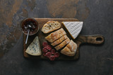top view of sliced bread, delicious cheese, salami and jam on wooden cutting board - 222121915