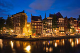 Amterdam canal, bridge and medieval houses in the evening - 222129524