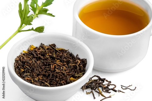 Fototapeta Cup of Green Tea with Dried Leaves Tea in Bowl