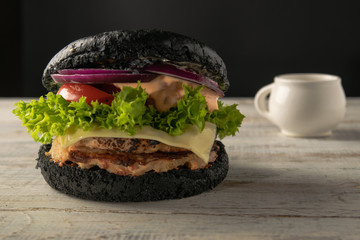White and black hamburgers are served in different angles and with different fillings