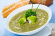 Cheese cream-soup from broccoli with soft cheese and bread, traditional dish