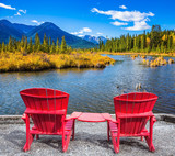 Two red chaise lounges on the lake - 222165906