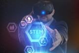 The concept of business, technology, the Internet and the network. A young entrepreneur working on a virtual screen of the future and sees the inscription: STEM - 222171757