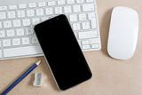 Modern smartphone on a keyboard - 222173734