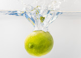 Fresh lime falling into the water. Suitable for advertisement. - 222177727