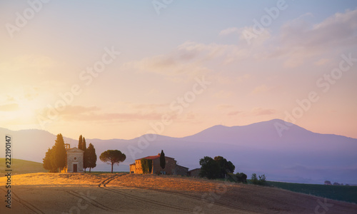 Foto Murales typical Tuscany countryside landscape; sunset over rolling hills and Tuscany farmland