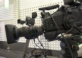 Professional tv camera in live show pavilion. - 222190748
