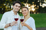 Favourite drink. Happy nice couple standing together while drinking red wine - 222194947