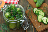 Homemade Pickling cucumbers.Table full of ingredients, cucumbers and spices - 222199767