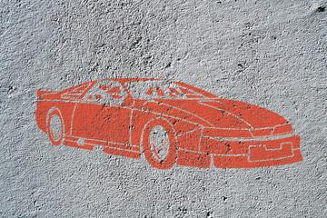 Street art, voiture de sport rouge