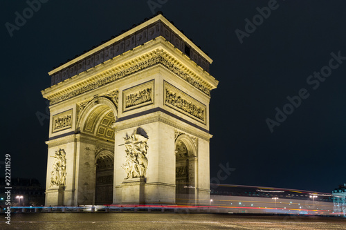 Street view of Arc de Triomphe (Triumphal Arch) in Chaps Elysees at night, Paris, France.