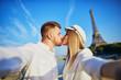 Leinwanddruck Bild - Romantic couple taking selfie near the Eiffel tower