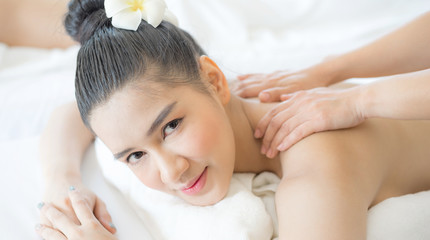 beautiful and healthy young woman relaxing with back massage in spa salon © suphaporn
