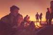 Leinwanddruck Bild - Couple enjoying bonfire with friends on beach