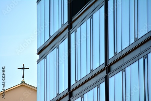 Foto Murales Abstract fragment of contemporary architecture, walls made of glass and concrete. Glass curtain wall of modern office building