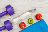 Different tools for fitness on floor in room