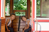 Beautiful children, dressed in vintage clothes, enjoying old steam train on a hot summer day - 222259131