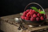 Rural still life with raspberries on rustic  table