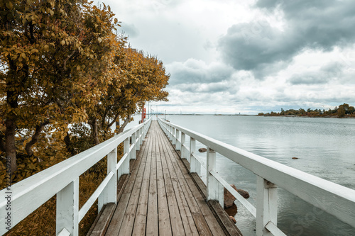 Wooden bridge along the shore of the Baltic Sea, in the capital of Finland, Helsinki, autumn landscape - 222261928