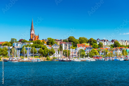 Leinwanddruck Bild Flensburg cityscape at summer day. Skyline of the old european town. Panoramic view of the small german city