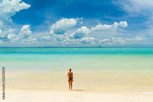 woman sunbathing  on the tropical beach - 222270529