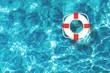 Leinwanddruck Bild - Life preserver floating in a clear pool water
