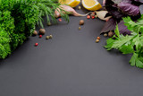 Collection of herbs and spices on a black background - 222276792