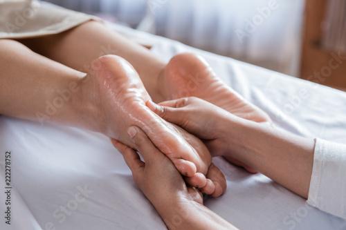 Leinwandbild Motiv Foot massage in spa salon, closeup