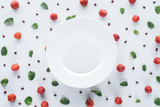 top view of ripe strawberries around empty plate on white surface - 222296188