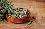 bowl with dried sage and fresh sage over wooden background - 222301360